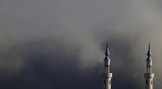 Smoke rises over Gaza City after an Israeli strike after a three-day truce ended (AP)