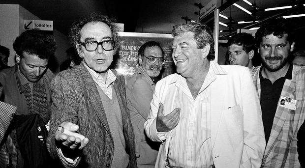 Swiss movie director Jean-Luc Godard with Israeli producer Menahem Golan, right, who has died aged 85 (AP)