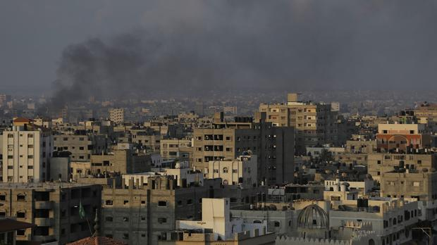 Smoke from a fire caused by an Israeli strike rises over Gaza City (AP)