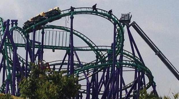 Firefighters rescuing riders stranded on a roller coaster in Maryland (AP/Prince George's County Fire Dept)