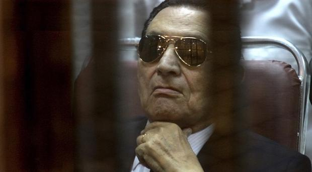 Ousted Egyptian president Hosni Mubarak is being retried over charges of failing to stop killings of protesters during the 2011 uprising (AP)