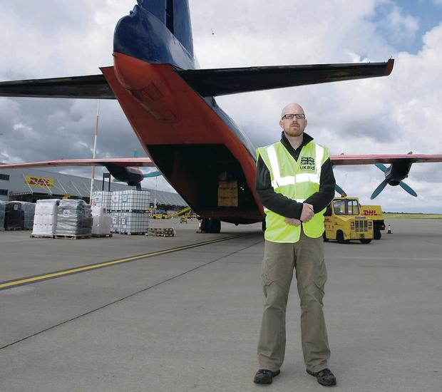 Manager Bob Gibbons oversees the loading of aid to Iraq at East Midlands Airport yesterday