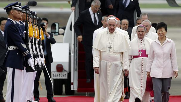 Pope Francis walks with South Korean president Park Geun-hye after arriving in Seoul (AP)