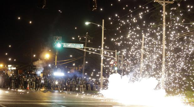 A device deployed by police goes off in the street during the clash with protesters in Ferguson, Missouri (AP)