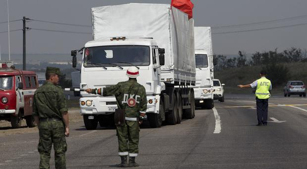 A convoy of white trucks with humanitarian aid is seen near the Ukrainian border, in Rostov-on-Don region, Russia (AP)