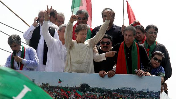 Pakistan's cricketer-turned-politician Imran Khan gestures during a rally heading to Islamabad (AP)
