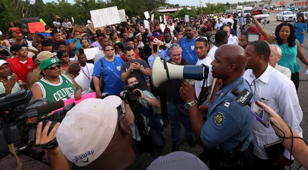 Captain Ron Johnson of Missouri State Highway Patrol addresses protesters in Ferguson (AP/St Louis Post-Dispatch)