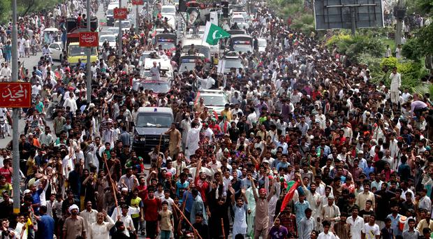 Supporters of Imran Khan march towards Islamabad (AP)