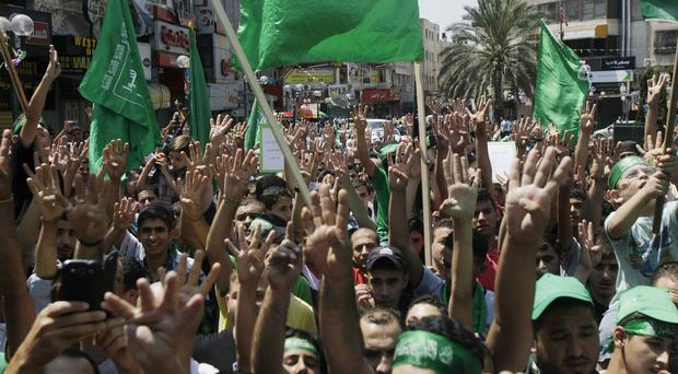 Hamas protesters during a demonstration in the West Bank city of Nablus (AP)