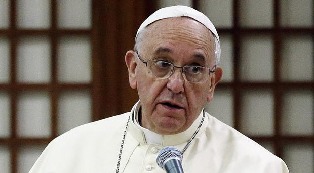 Pope Francis has called for 'fraternal' dialogue with China and North Korea (AP)