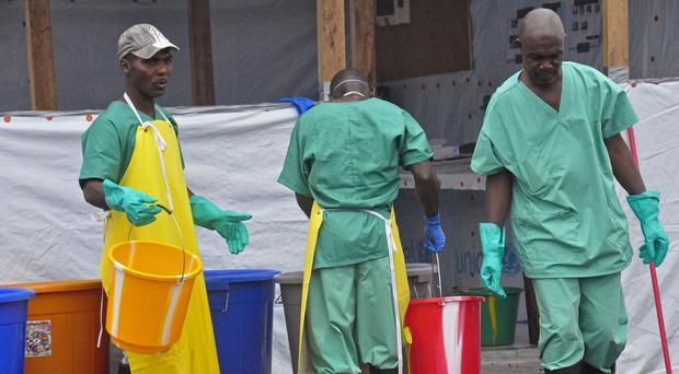 Health workers at an Ebola treatment centre in Monrovia (AP)