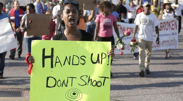 Protesters in Ferguson protest over the shooting of Michael Brown, who was killed by police on August 9 (AP)
