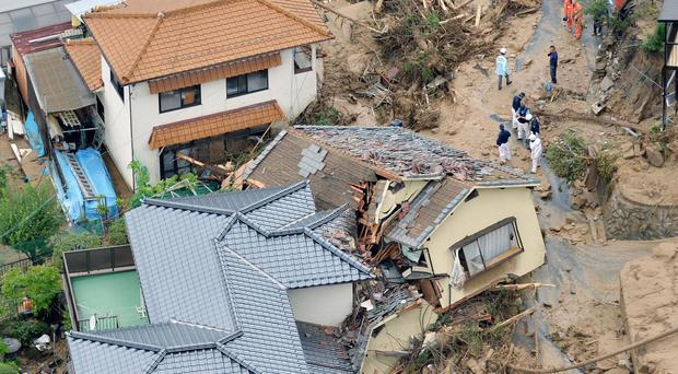 In this aerial photo, heavily damaged houses are seen after a massive landslide swept through residential areas in Hiroshima (AP/Kyodo News)