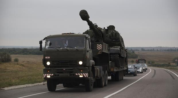 A Russian military truck carries an MSTA-S self-propelled howitzer about 10 kilometres from the Russia-Ukrainian border control point at Donetsk (AP)