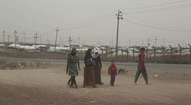 Internally displaced Iraqis arrive at a camp in Feeshkhabour, Iraq (AP)
