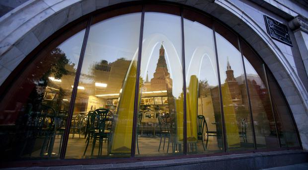 One of closed Moscow McDonald's restaurants with the Kremlin reflected in a window (AP)