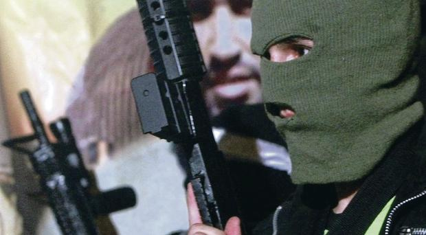 A Palestinian militant holds his weapon during a protest against Israeli operations in Gaza