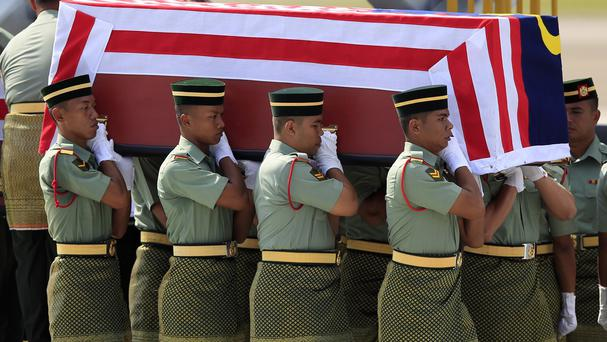 Malaysia Army soldiers rehearse the handover ceremony for bodies of the downed plane, at Kuala Lumpur International Airport
