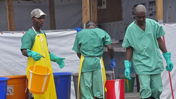 Health workers at an Ebola treatment centre in the city of Monrovia, Liberia (AP)