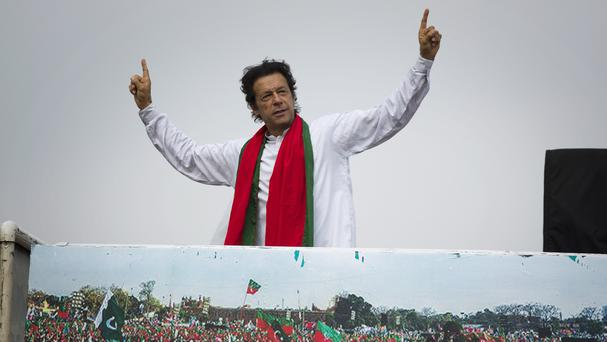Imran Khan waves to his supporters gathering near parliament in Islamabad, Pakistan (AP)