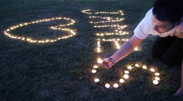 Candles are lit on the town common during a vigil for James Foley in his home town of Rochester, New Hampshire (AP)