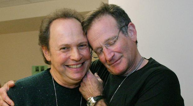 Billy Crystal, left, pictured with Robin Williams, paid tribute to the late actor at the Emmy Awards in Los Angles (AP)
