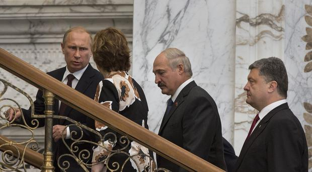 Russian President Vladimir Putin talks to EU foreign policy chief Catherine Ashton in Minsk. (AP)