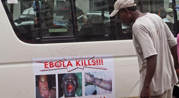 An Ebola warning on the door of a vehicle in Monrovia, Liberia (AP)
