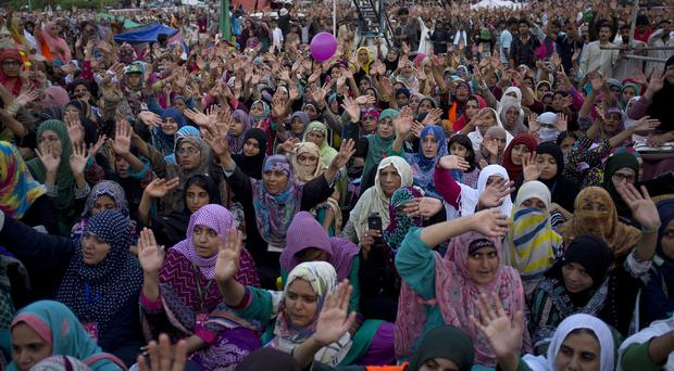 Supporters of Pakistan's Muslim cleric Tahir-ul-Qadri demonstrate near the parliament building in Islamabad (AP)