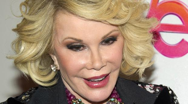 Joan Rivers was rushed to a New York City hospital after reportedly suffering a heart attack (AP)