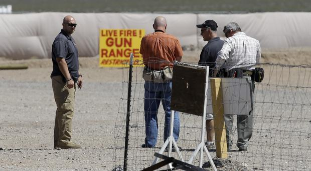 People are seen at the Last Stop outdoor shooting range in White Hills, Arizona, where instructor Charles Vacca was accidentally killed (AP)