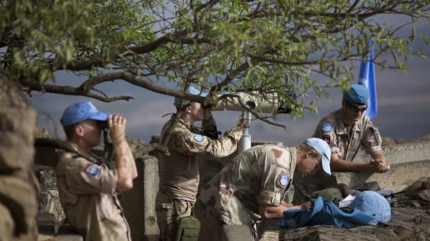 United Nations peacekeepers observe Syria's Quneitra province from Mt Bental in the Israeli-controlled Golan Heights (AP)