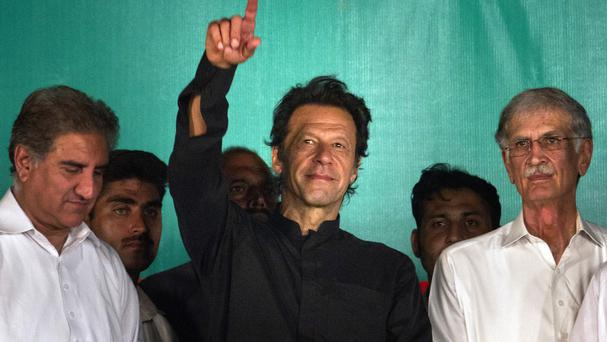 Imran Khan waves to his supporters during a protest near the parliament building in Islamabad, Pakistan (AP)