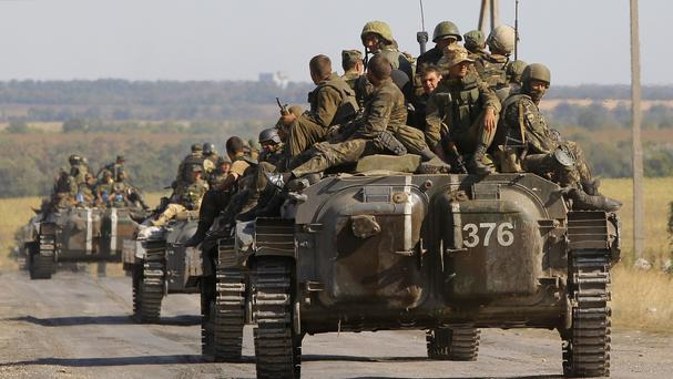 Ukrainian troops evacuated from the rebel-held town of Starobesheve (AP)