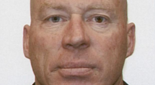 A police dog unit apprehended 48-year-old John Tully near a lake following an extensive manhunt (AP/New Zealand Police)