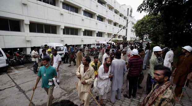 Pakistani protesters gather at the state television building in Islamabad (AP)