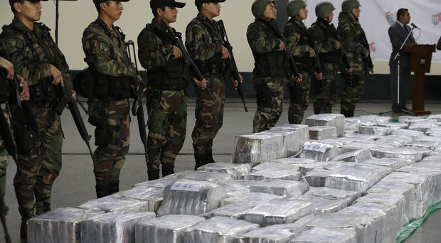 Police stand guard over the seized cocaine Lima (AP)