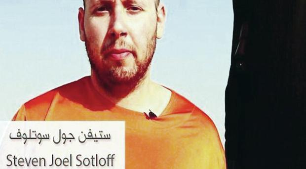 US journalist Steven Sotloff in the internet video posted by Islamic State militants yesterday purporting to show his beheading