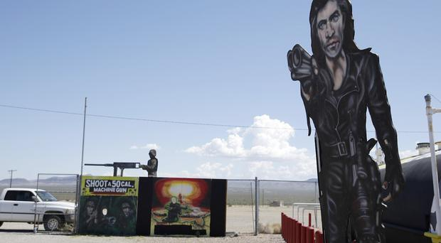 Painted signs outside the Last Stop outdoor shooting range, in White Hills, Arizona where Charles Vacca was accidentally killed (AP)