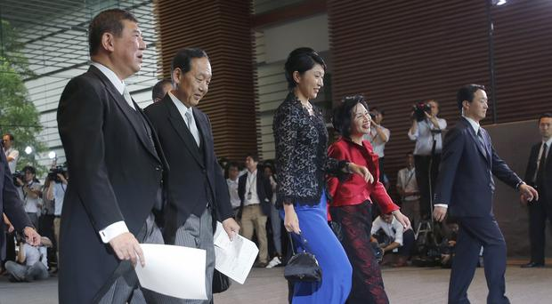 Newly appointed ministers leave the prime minister's office for the Imperial Palace for the attestation ceremony in Tokyo, Japan (AP)