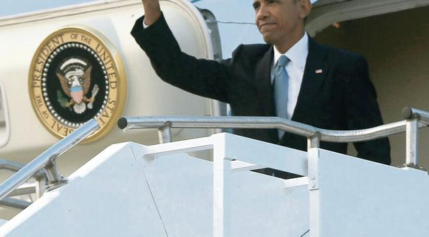 President Barack Obama waves as he arrives on Air Force One at Royal Air Force Station Fairford to attend the Nato summit in Wales yesterday