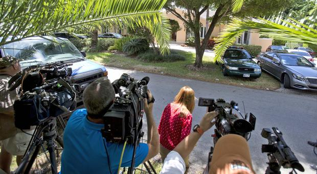 Television journalists stand outside the home of the family of Steven Sotloff in Florida (AP)
