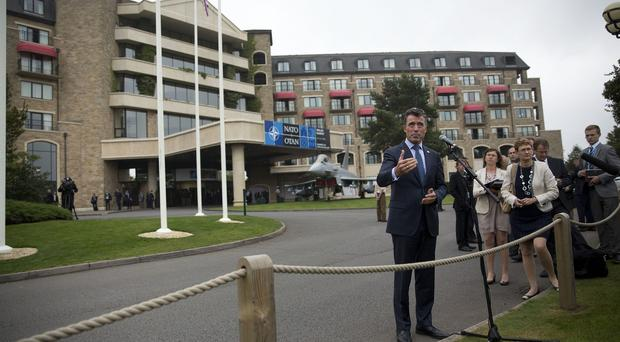 The Taliban has taunted world leaders attending the Nato summit in Wales as it launched a new attack in Afghanistan (AP)