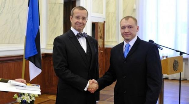 Estonian security service officer Eston Kohver, right, receiving a decoration from the Estonian President Toomas Hendrik Ilves (AP)