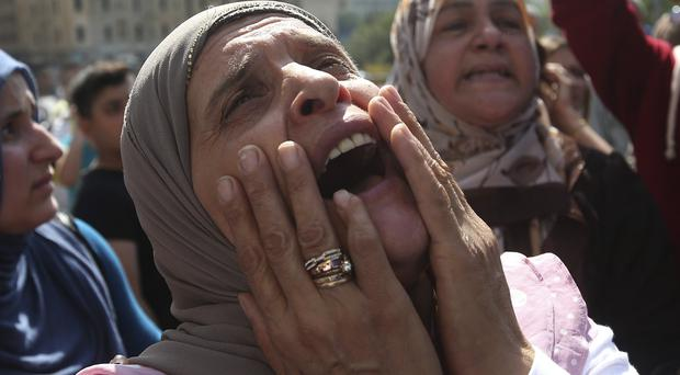 The mother of a missing Lebanese soldier kidnapped by Islamic State militants, joins a demo in Beirut demanding action to free the captives