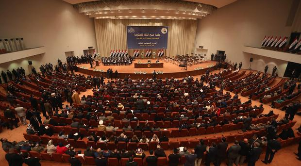 Iraqi lawmakers attend the session to approval the new government in Baghdad (AP)