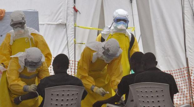 Health workers attend to patients with the Ebola virus at a clinic in Liberia (AP)