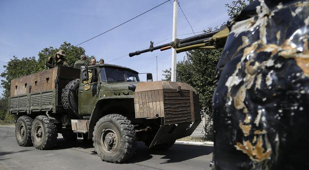 Pro-Russian rebels drive an armoured truck in Donetsk, eastern Ukraine (AP)