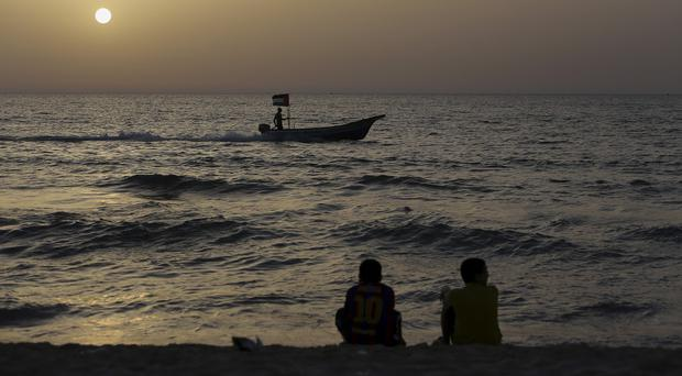 A fisherman sails on his boat off the coast of Gaza (AP)