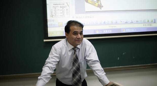 Ilham Tohti was arrested earlier this year in Beijing (AP)